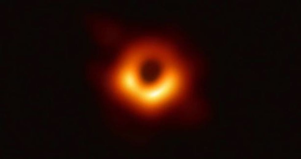A photo of this researcher's unbridled joy after creating the first black hole image is going viral.