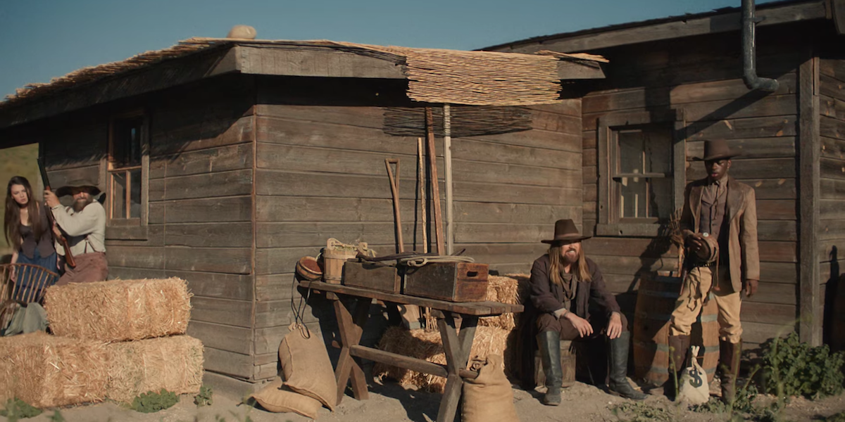 """Lil Nas X And Billy Ray Cyrus Time Travel On Horseback For """"Old Town Road"""" Video"""