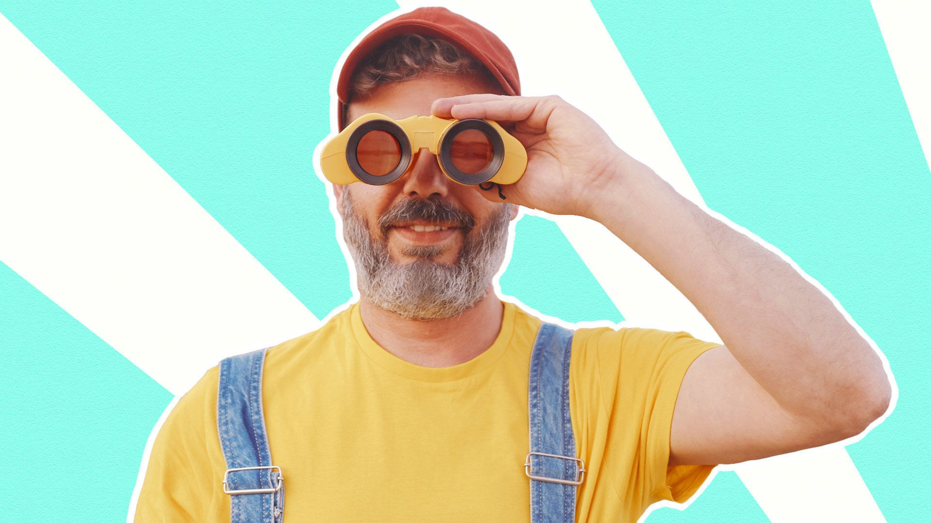 Man with binoculars and a hat looks forward
