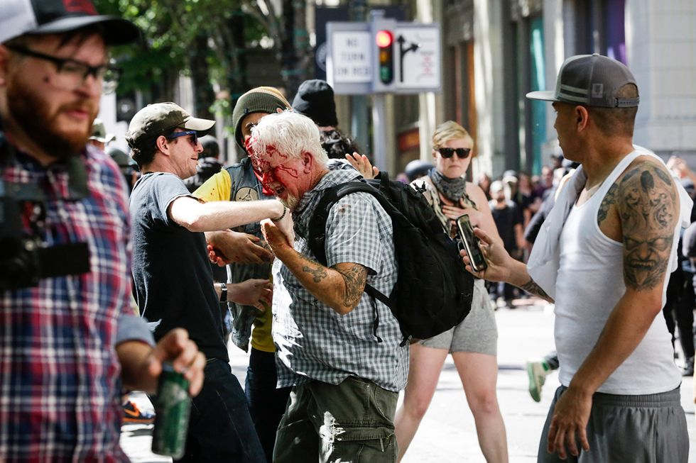 The Rose City Antifa brutally attacks an unidentified right aligning man at Pioneer Courthouse Square on June 29, 2019 in Portland, Oregon. Several groups from the left and right clashed after competing demonstrations at Pioneer Square, Chapman Square, and Waterfront Park spilled into the streets. According to police, medics treated eight people and three people were arrested during the demonstrations.