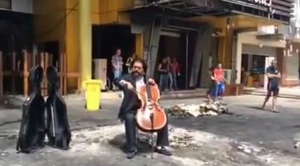At Baghdad's Bomb Sites, Chaos, and a Cellist Playing Music