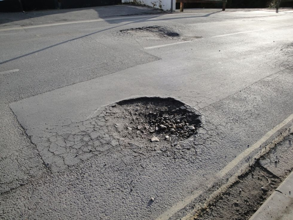 When This City Couldn't Fix Its Potholes, These 'Guerrilla Road Radicals' Stepped Up Instead