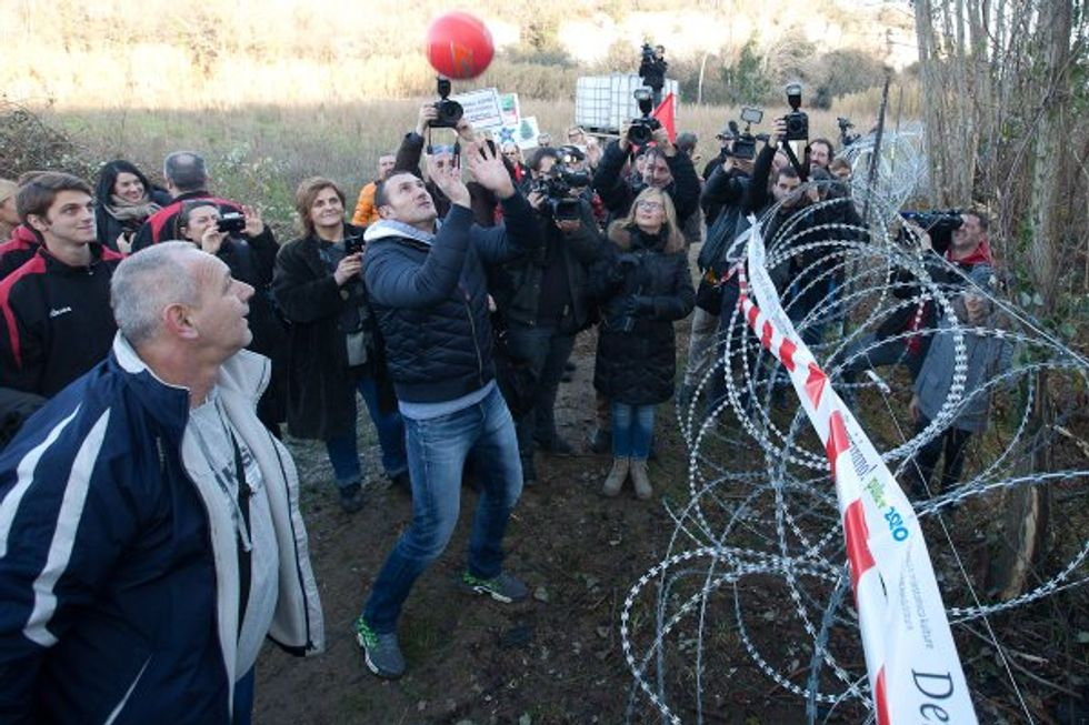 Protesters Play a Delightful Game of Volleyball Across the Slovenia-Croatia Border Fence