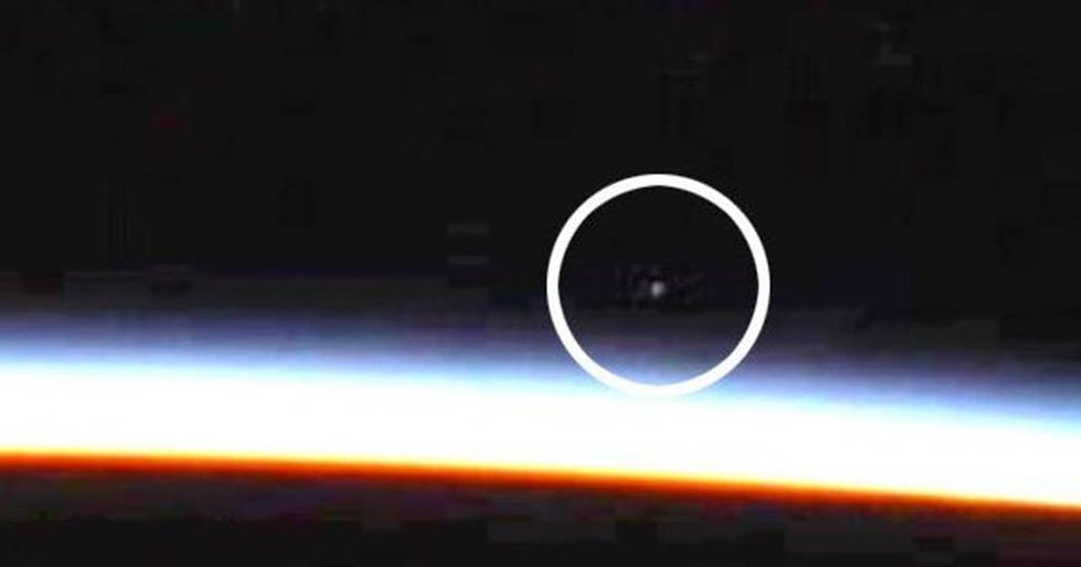 Did A NASALive Stream Capture A UFO Above The Earth's Atmosphere?