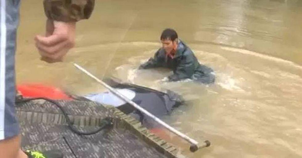 Good Samaritans Save A Woman And Her Dog During Louisiana Flood