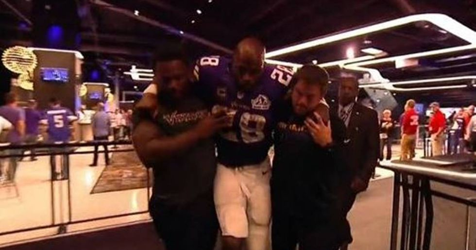 Adrian Peterson Escorted Through A Bar After Knee Injury
