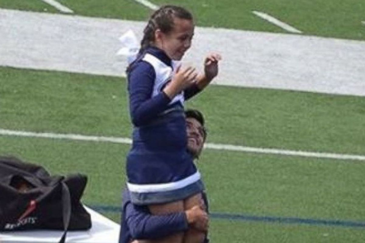 A 9-yr-old cheerleader's veteran dad couldn't help with her routine, so a high schooler ran to her side