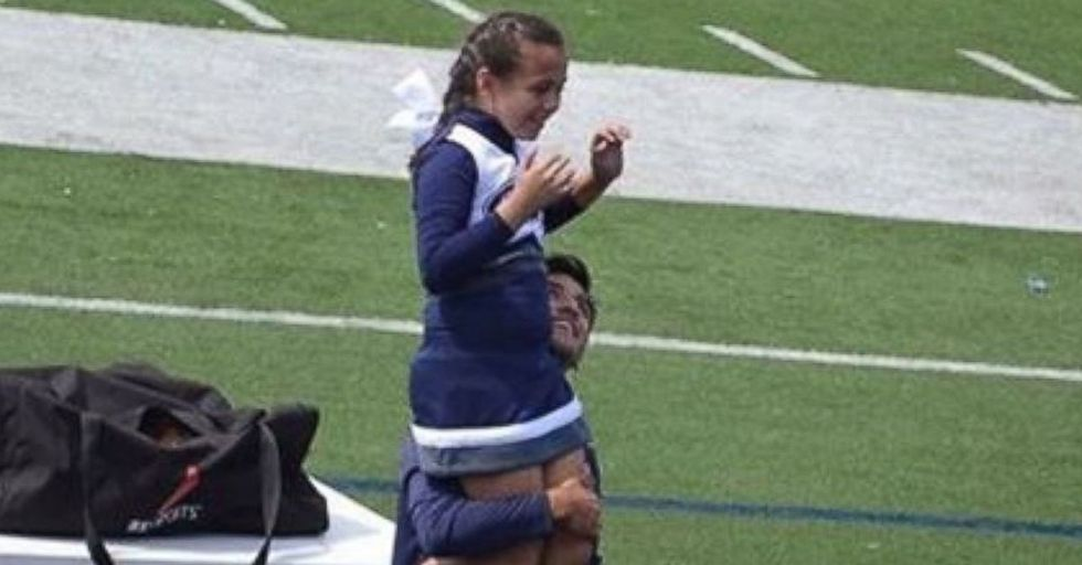 A 9-Year-Old Cheerleader's Veteran Dad Wasn't Able To Help With Her Routine, So A High School Senior Ran To Her Side