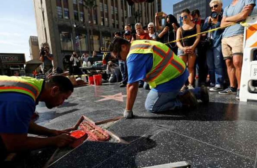Hispanic Men Insulted By Trump Repaired His Vandalized Star On the Walk Of Fame