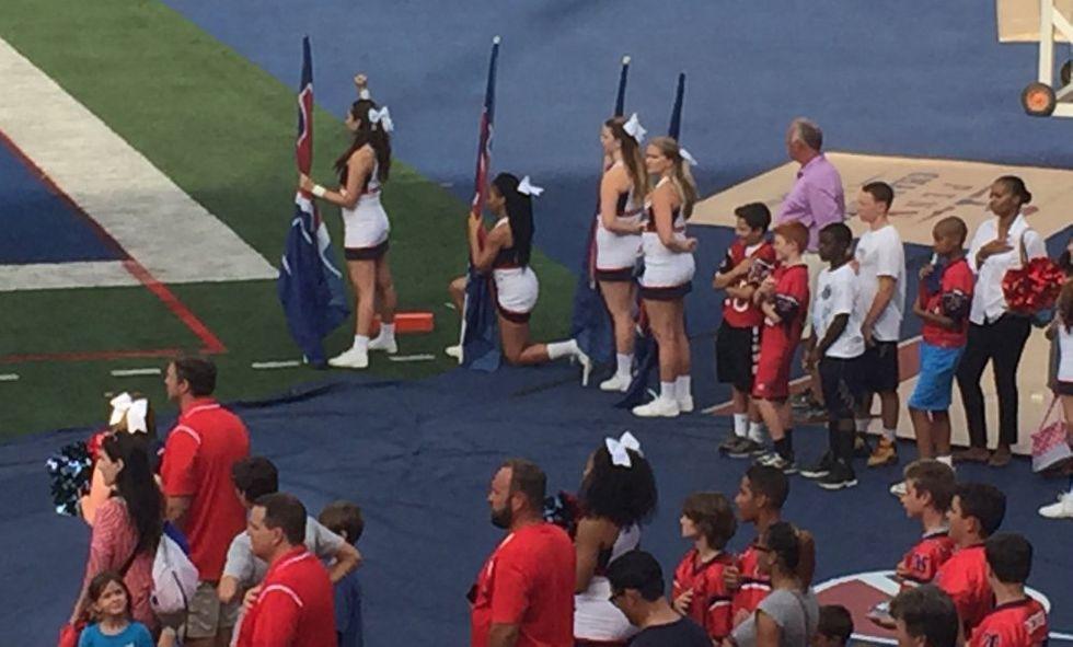 The Protesting Cheerleaders At Trump's Alma Mater