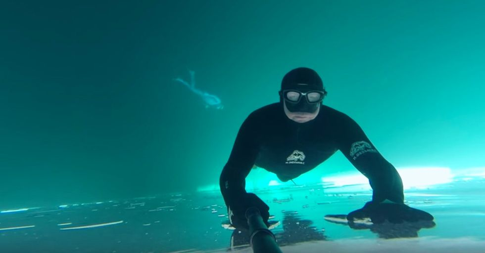 A Free Diver Makes A Beautifully Haunting Video While Swimming Under A Frozen Lake