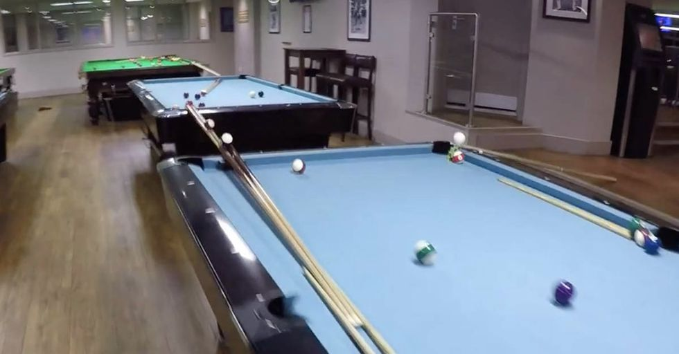 This Jaw-Dropping Trick Shot Requires a Putter, Nine Pool Tables, A Staircase, And A Bar