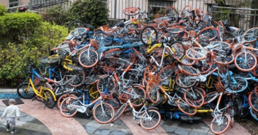 Giant Piles Of Discarded 'Shared Bikes' Are Turning Chinese Sidewalks Into Dumping Grounds