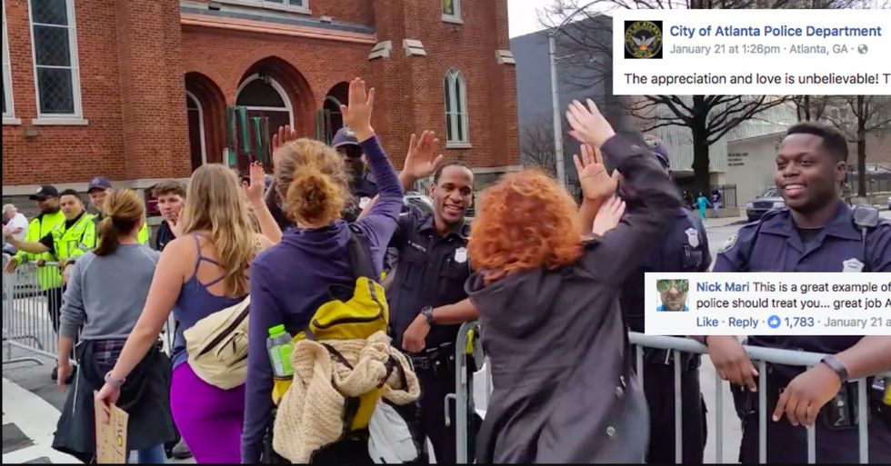 Police High-Fiving Women's March Protesters Is Just Awesome