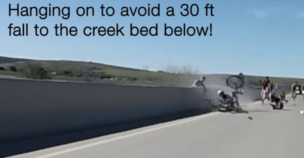 Cyclist Takes Drastic Measures To Avoid A 30-Foot Fall After A Spectacular Crash During Race