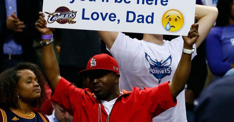 Dad uses awesome signs at NBA games to taunt son about his grades.