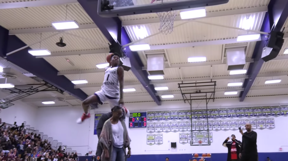 High School Basketball Star Dunks Over Mom And Dad To Win Contest
