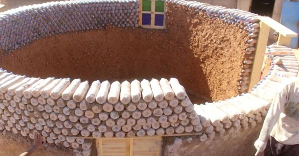 Refugee Transforms His Village By Creating Homes Out Of Discarded Plastic Bottles