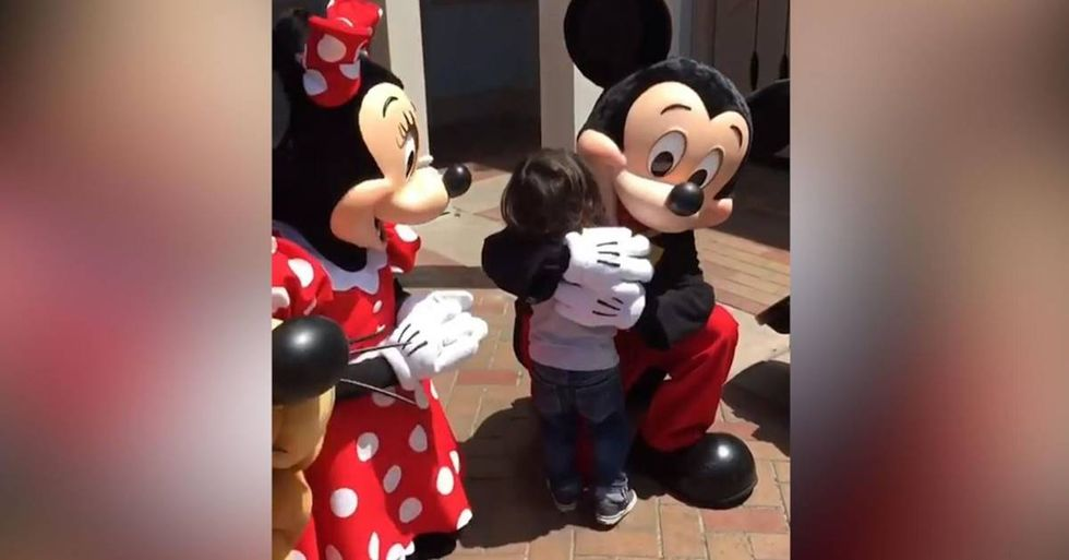 Touching Video Shows Disney Characters Signing With A Young Boy