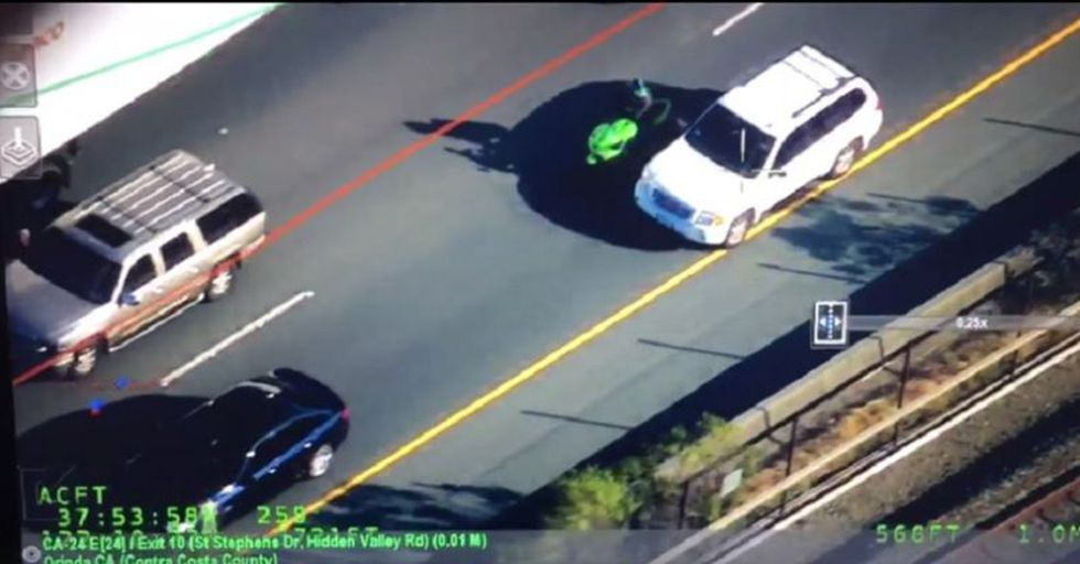 Police Chopper Films A Motorcyclist Smashing Car Mirrors, Then Brings Him To Justice