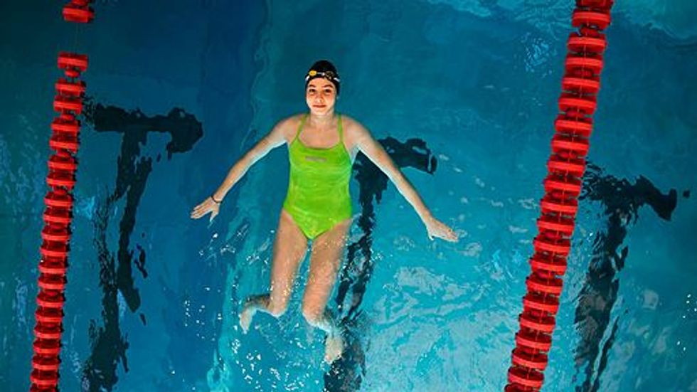 Syrian Refugee Turned Olympic Swimmer Faces Fears In Return To Budapest