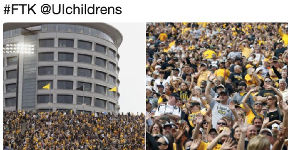 College Football Crowd Stops To Wave To Children At Nearby Hospital