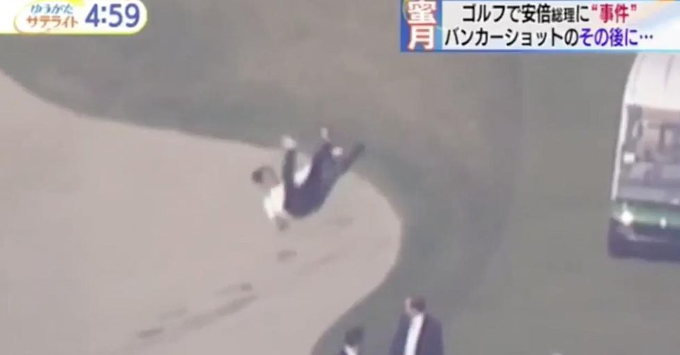 The Japanese Prime Minister Took A Fall Into A Sand Trap While An Impatient Trump Marched Down The Golf Course