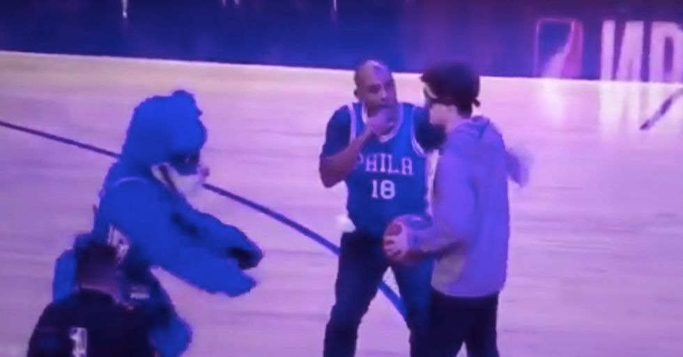 The 76ers Tricked A Blindfolded Fan Into Thinking He Made A 3-Pointer In This Brutal Prank
