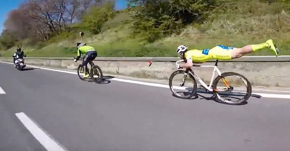 Random Act Of Sports: Cyclist Uses An Impressive Acrobatic Pose To Cruise By His Competition
