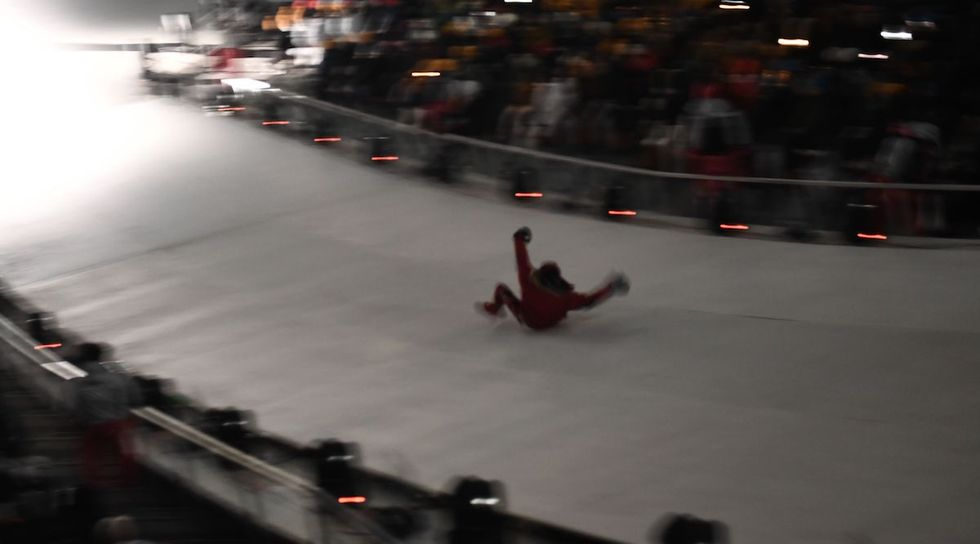 A Fearless Fan Snuck His Way Onto An Icy Slide During The Olympics Opening Ceremony