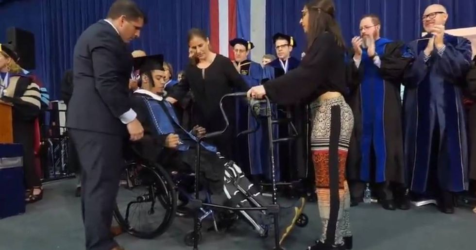 After Being Partially Paralyzed, A Former Georgetown Linebacker Walks For The First Time At Graduation