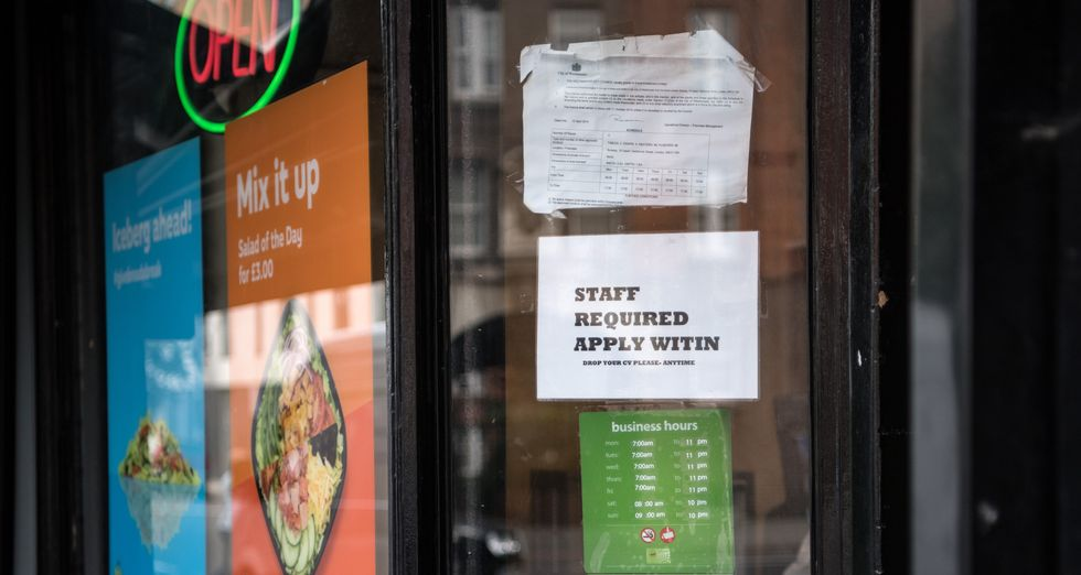 Woman calls out restaurant that fired her for being pregnant in viral Facebook post.