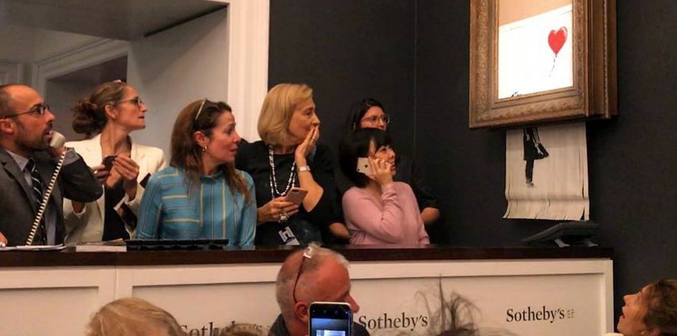 Banksy reveals how he built his 'self-destructing' painting that shredded after auction.