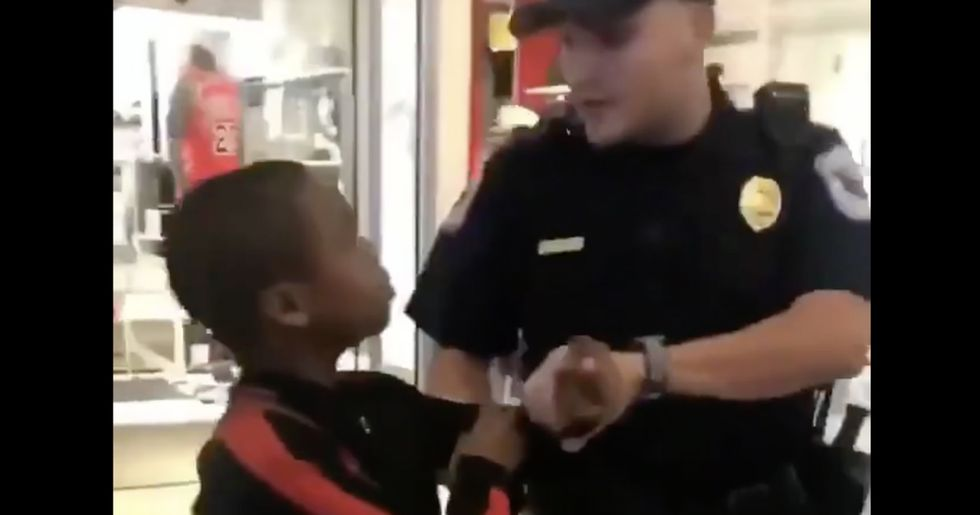 Woman fights back against cop harassing her 12-year-old nephew for selling his rap CD at the mall