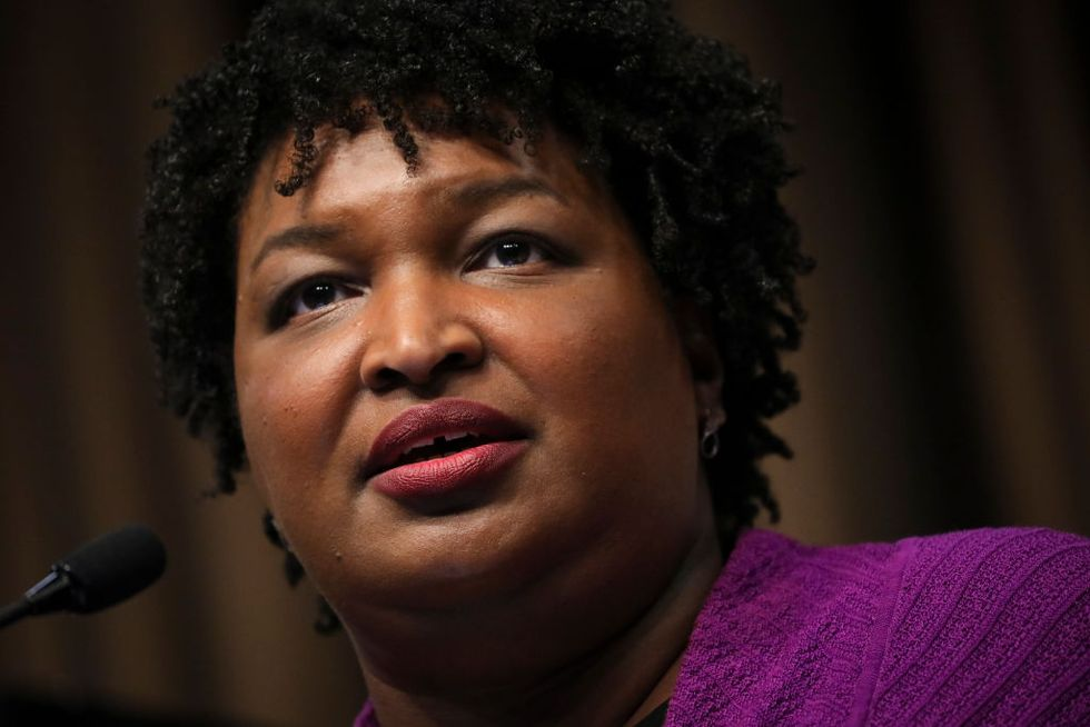 Democratic star Stacy Abrams was recently $200,000 in debt and wants to end the stigma others face over financial insecurity.