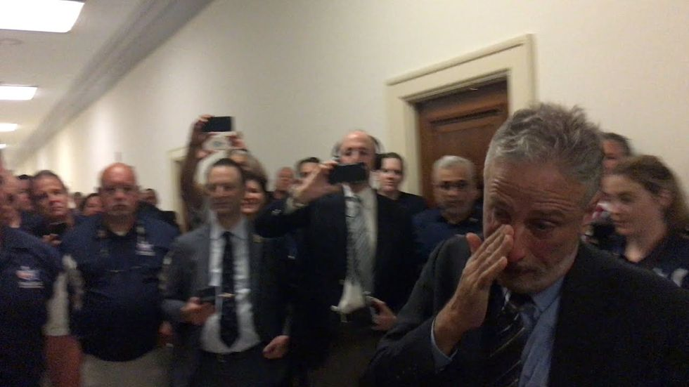 Jon Stewart unable to hold back tears when receiving 9/11 heroes' gift.
