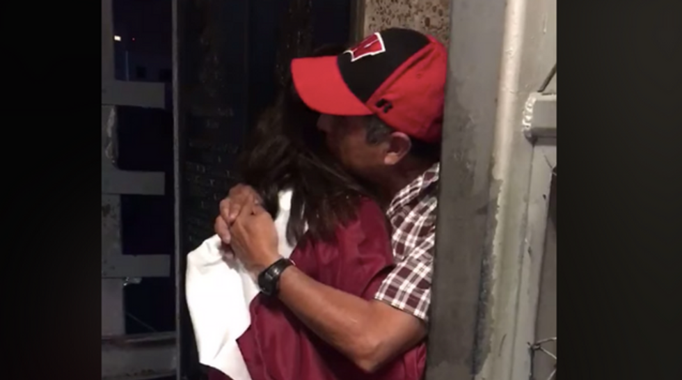 These photos of a high school grad embracing her Dad at the border reminds us what's at stake in the immigration debate.