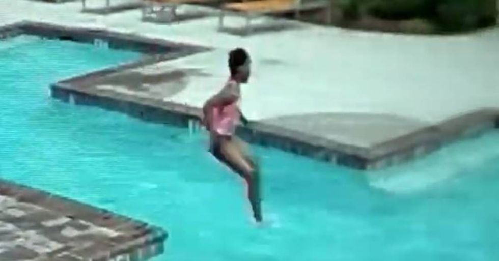 A surveillance camera caught intense footage of a ten-year-old girl saving her infant sister from drowning.