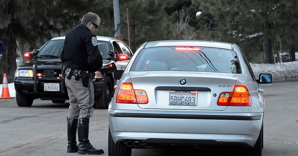 Why do police tap your tail light when you're pulled over?