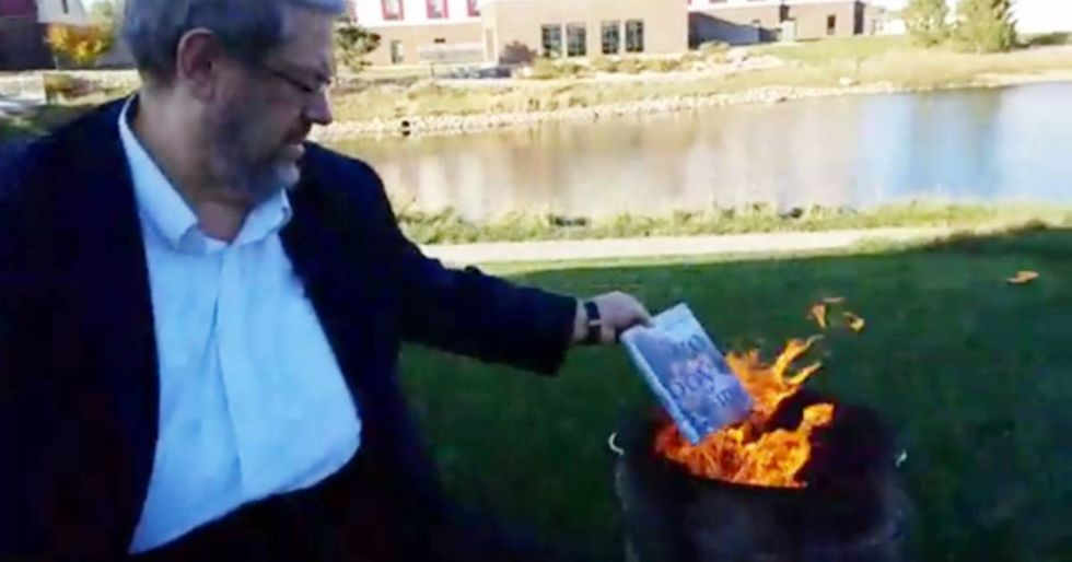 A homophobic man burned LGBT books at a gay pride festival and it backfired perfectly.