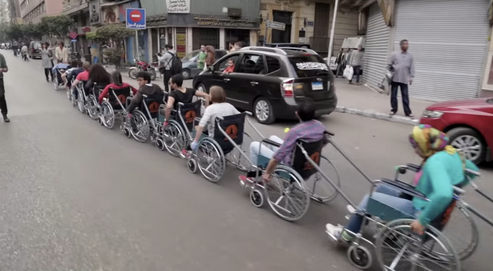 """These Artists Staged a """"Wheelchair Invasion"""" of Cairo's Streets"""