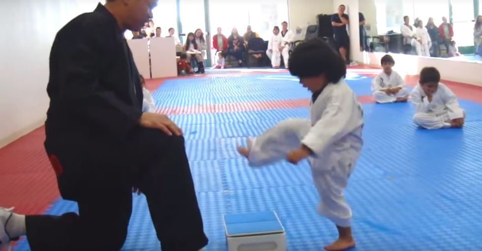 You've Never Seen Anyone More Determined Than This 3-Year-Old Trying to Break a Board