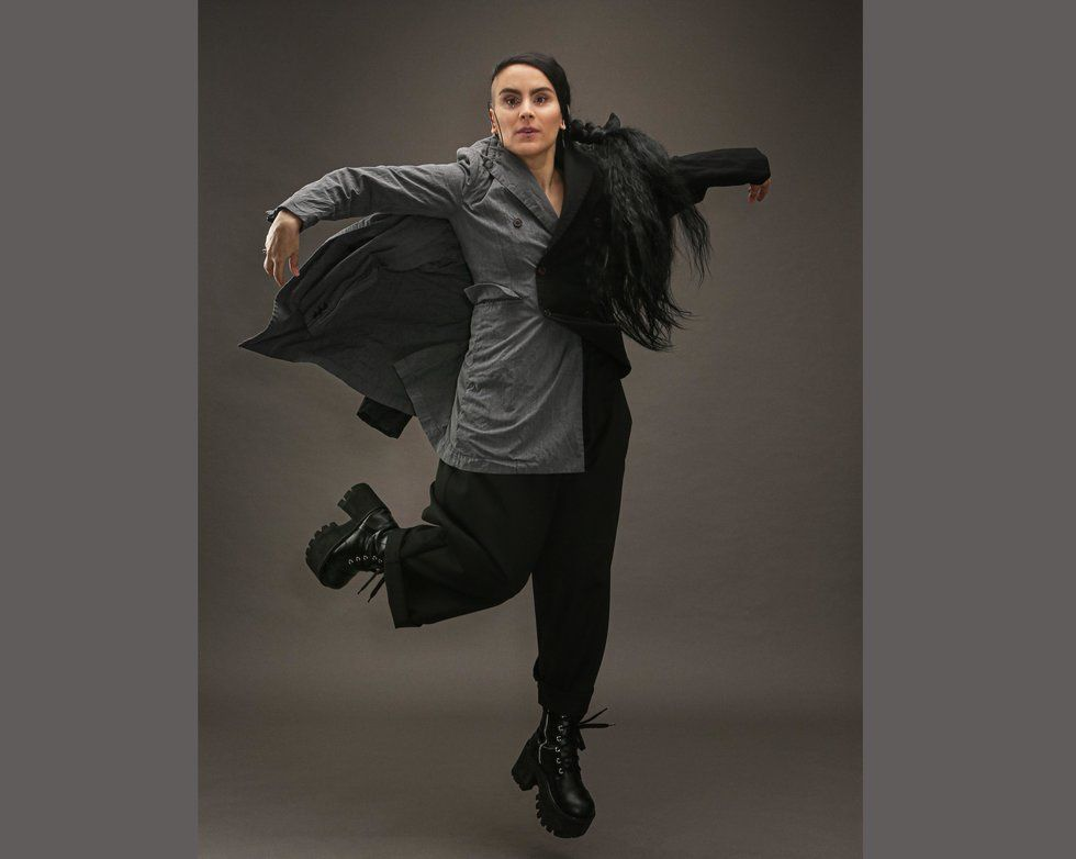 Sonya Tayeh jumps into the air with one leg bent