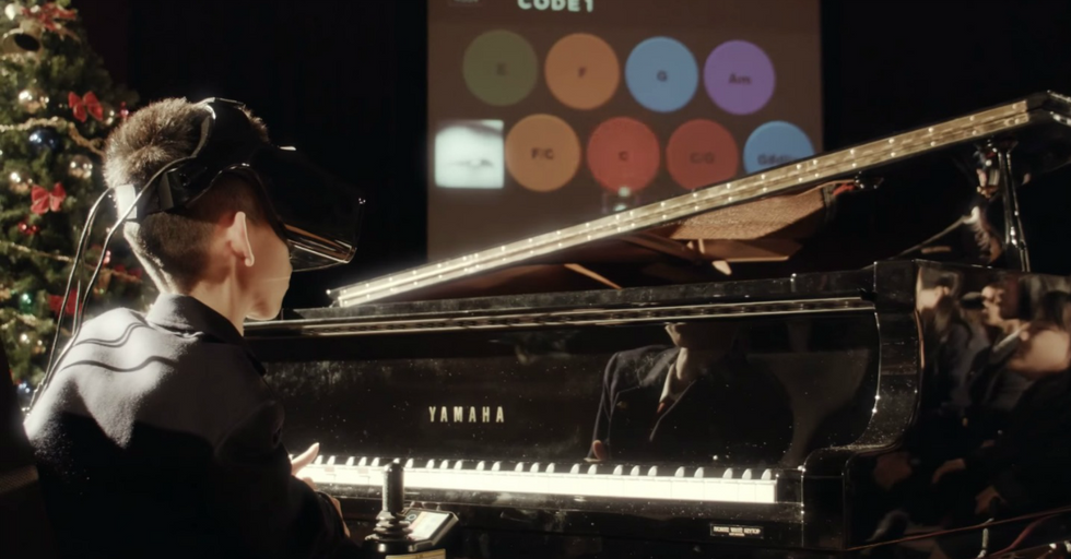 Japanese Helmet Cam Teaches Kids with Disabilities How to Rock Out on the Piano