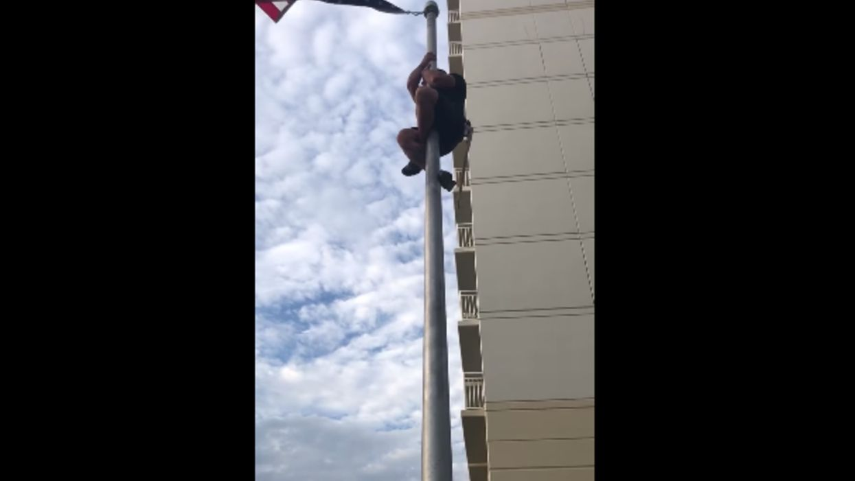 Video of former Navy SEAL climbing a flagpole to fix US flag goes viral — and he closes with a Bible verse