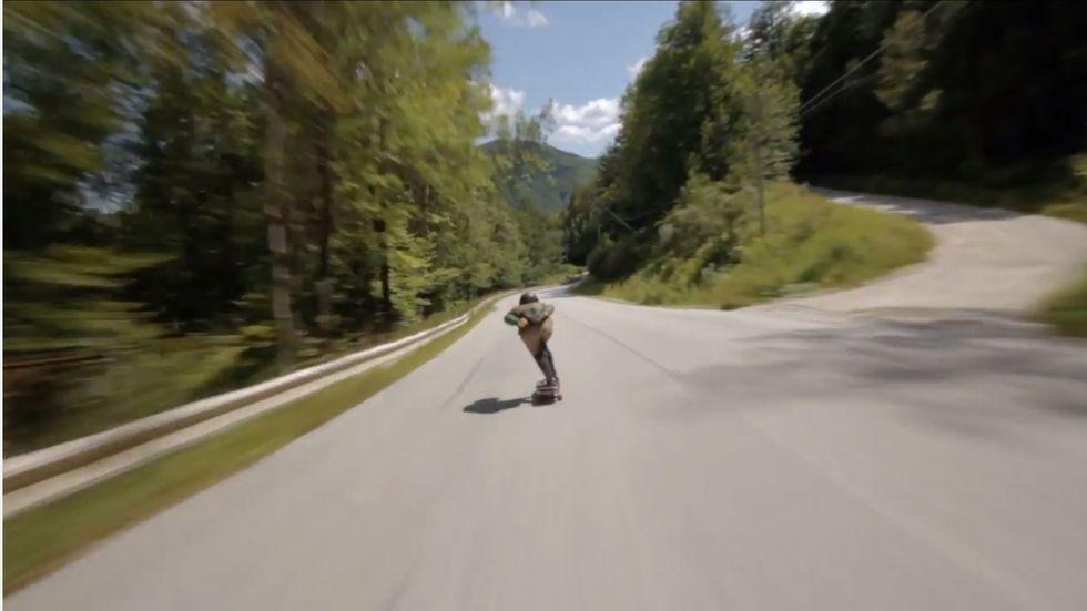 Watch Skateboarders Hit 70 MPH In Wild Downhill Race