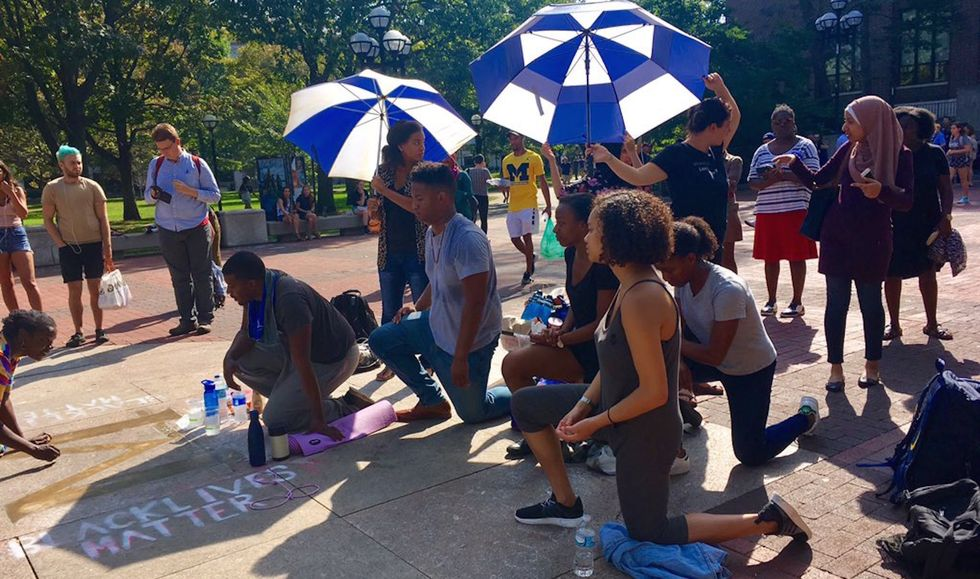 University Of Michigan Student Kneels For 20 Hours Straight To Protest Injustice On Campus