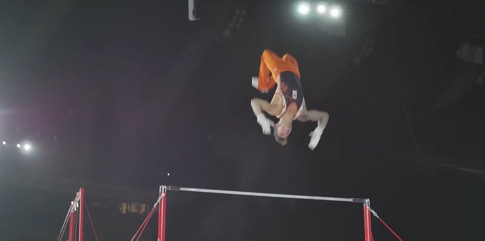 A Gymnast Gave The Crowd A Scare After Falling From The High Bar During His Routine