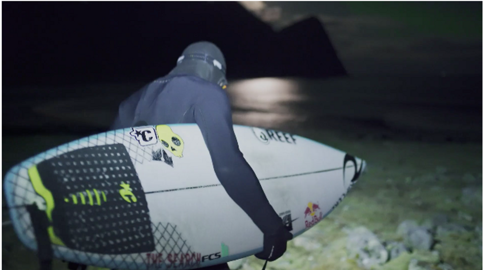 Surfing Under The Northern Lights Is As Beautiful As It Sounds