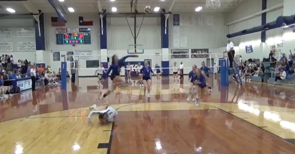 A High School Volleyball Player Makes A Superhuman Leap To Save The Play And The Point